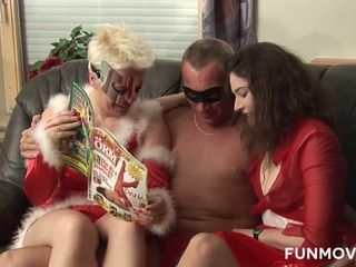 Two damn whores wearing Santa Claus outfits give blowjob to one lucky dude