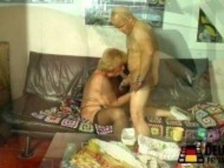"""Blonde grandma with immense tits"""