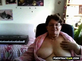 Insane grandmother showing her immense jugs on web cam