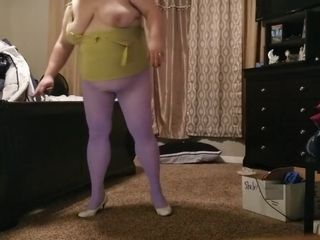 Plumper in torn colored pantyhose completing