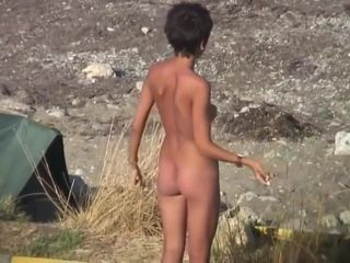 Naked circus performer on the beach. Spy