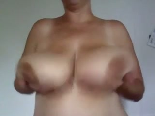 The immense tits babe likes toying with her massive tits and she's so super-naughty