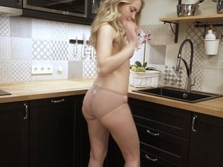 Loveliest light-haired housewife Sophie is tugging cooch on the table