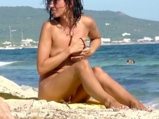 Latina cougar mother on the beach totally bare in public showcasing cock-squeezing coochie!