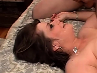 Brief haired big-boobed cougar has her beaver drilled in couch