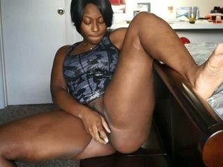 This black cam model is cramming giant bum and she luvs organic playthings