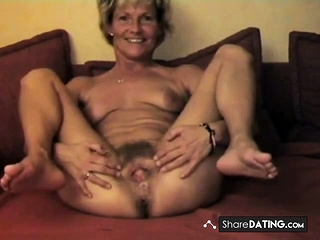 Mature shows Her cute unshaved puss