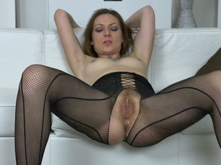 Sizzling solo spectacle of stellar cougar in crotchless bod fishnets