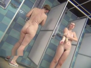 Real public showers with covert webcam set inwards