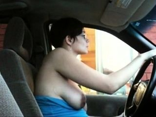 Chick flashing her boobs in a drive thru