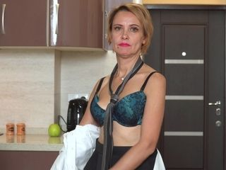 Bossy Russian nymph Oliya is wanking vagina in the kitchen