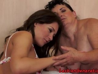 Lesbian babe toying with grannys hairy pussy